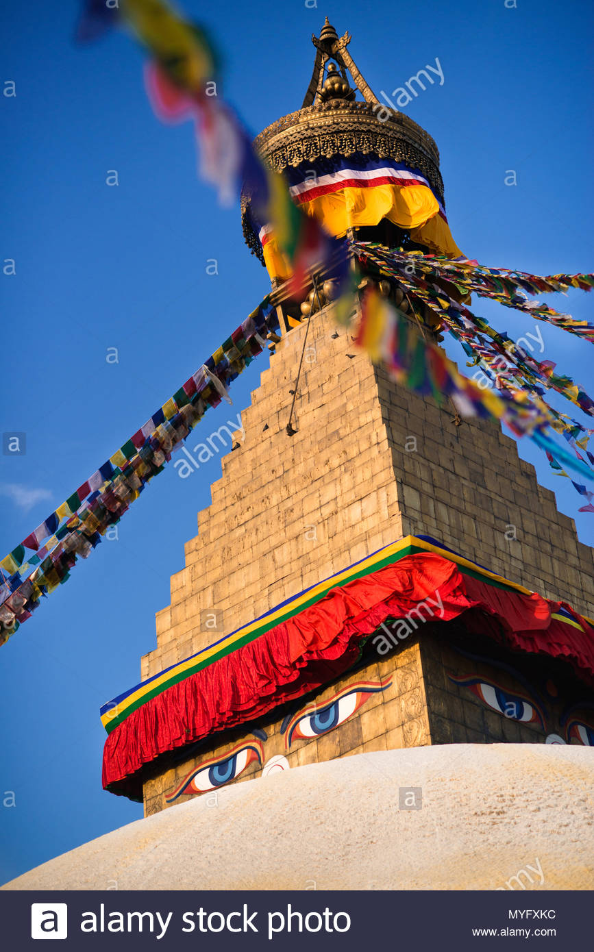 The eyes of Buddha on a golden stupa at Boudhanath. - Stock Image