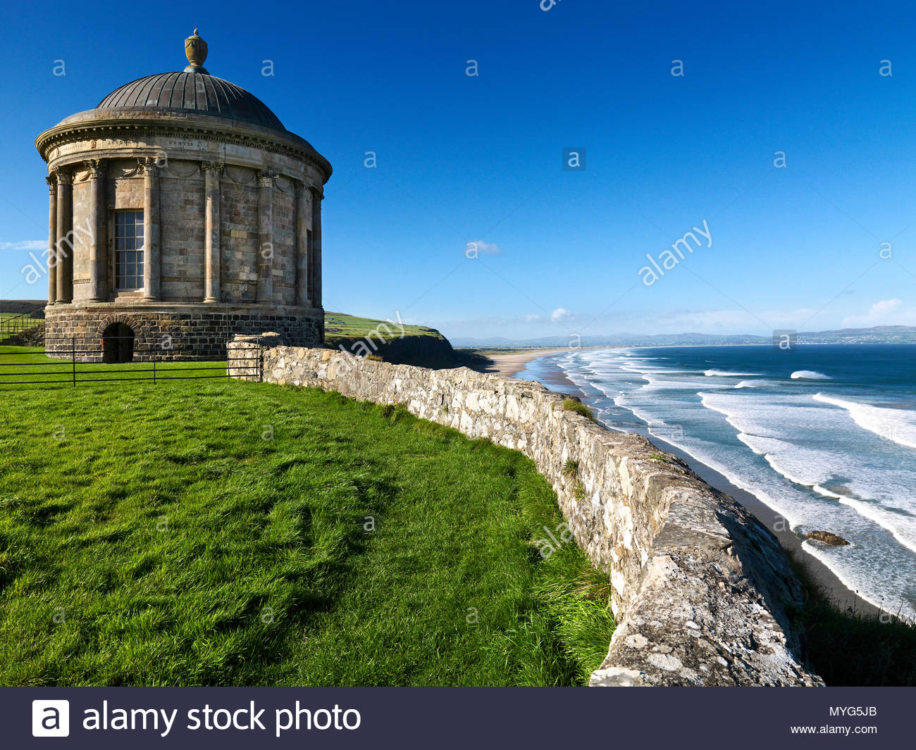 Folly temple on cliff edge overlooking the ocean. - Stock Image