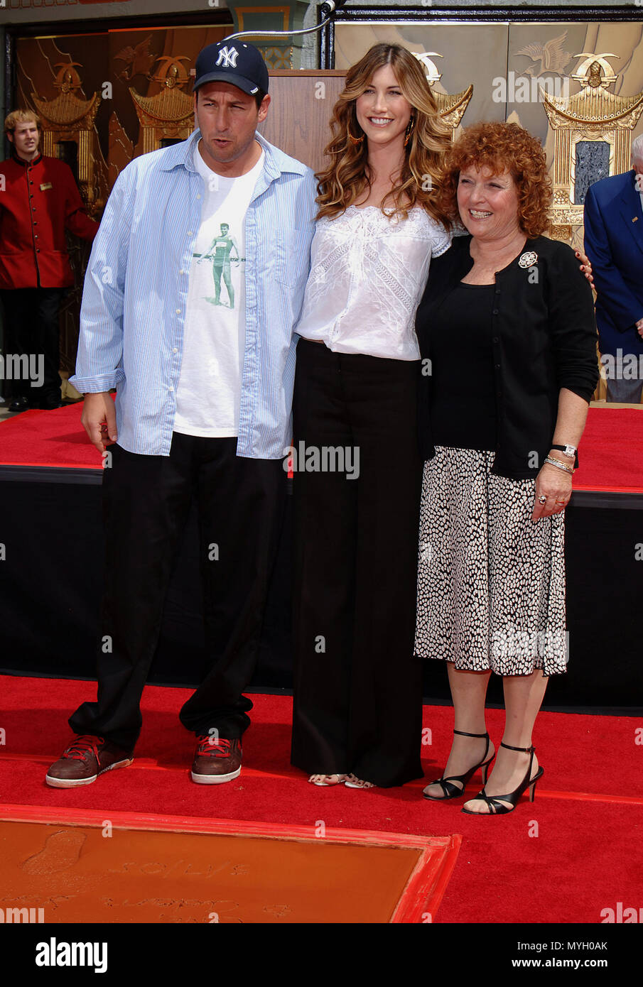 Adam Sandler with his wife jacqui and his mom at the Hands