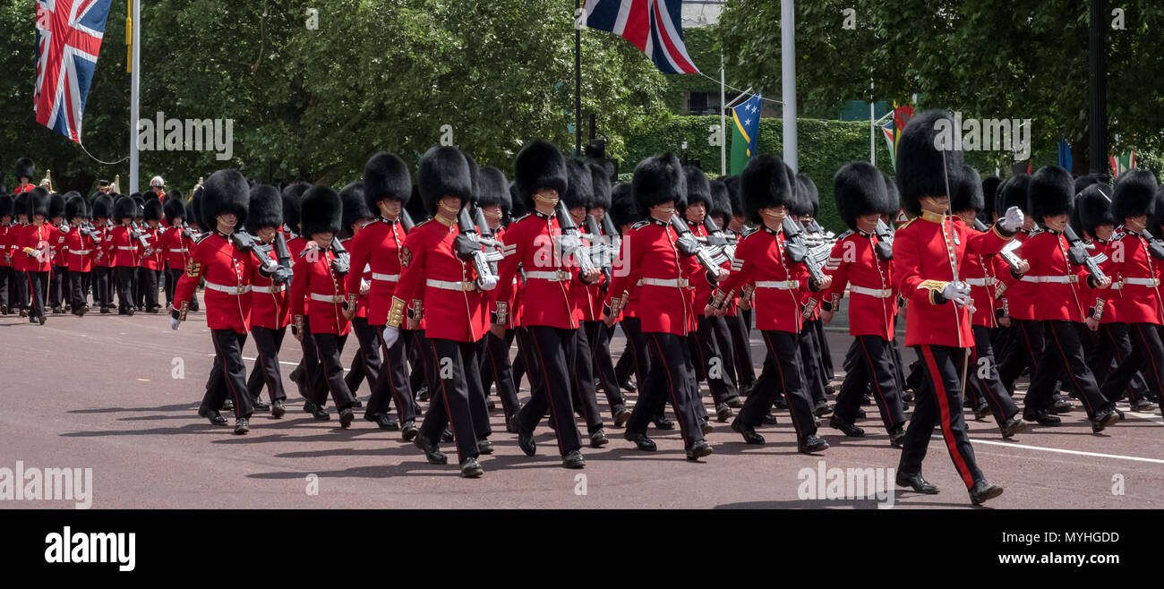 London UK. Panorama of Guardsmen marching down the The Mall, Westminster during the Trooping the Colour queen's birthday parade. - Stock Image