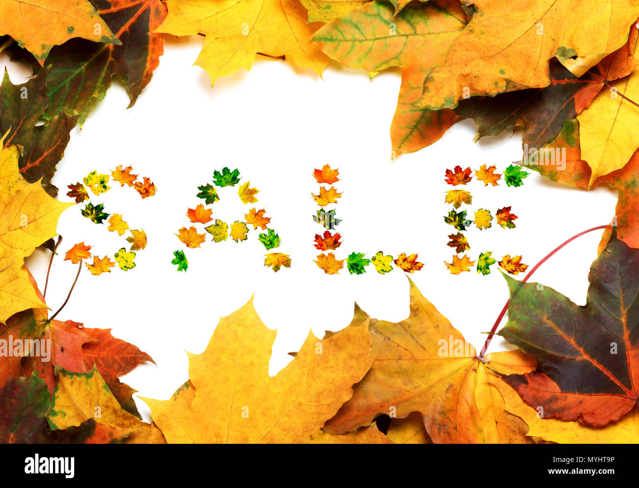 Frame of autumn multicolor maple-leafs with word SALE composed of ...