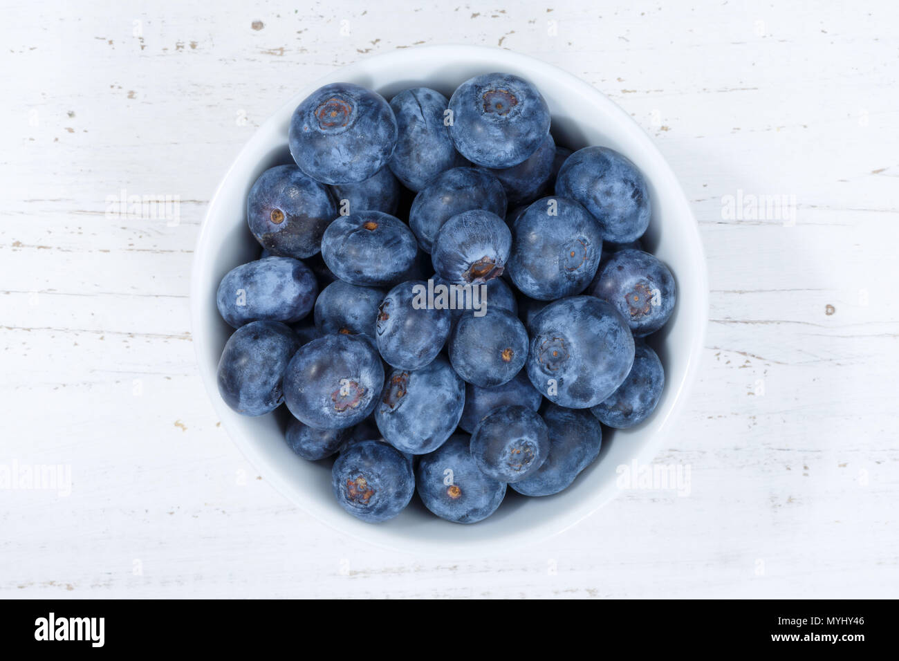 Blueberries berries from above bowl wooden board wood - Stock Image