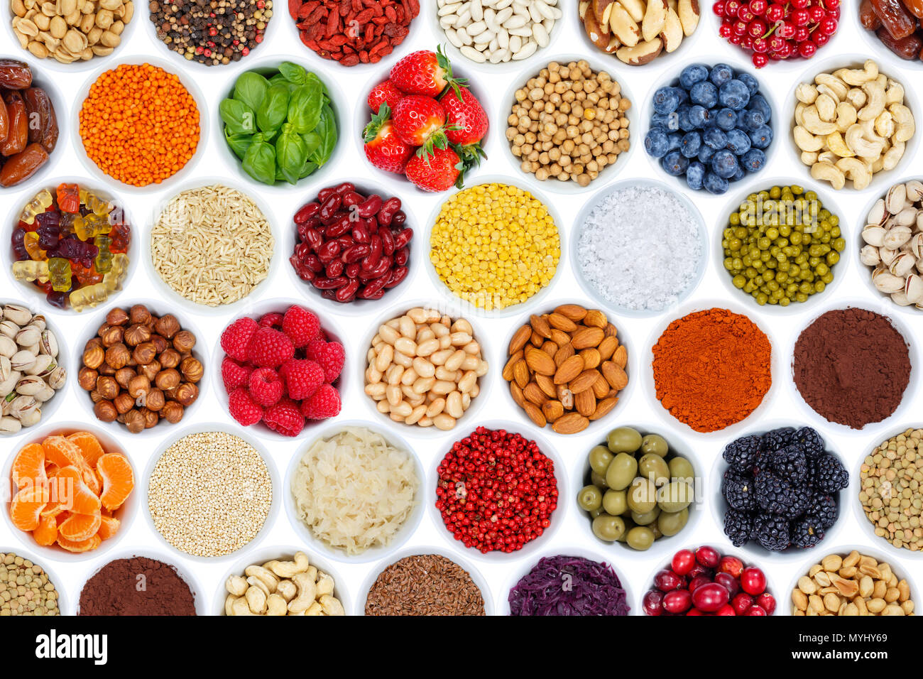 Collection of fruits and vegetables berries background from above isolated on a white background - Stock Image