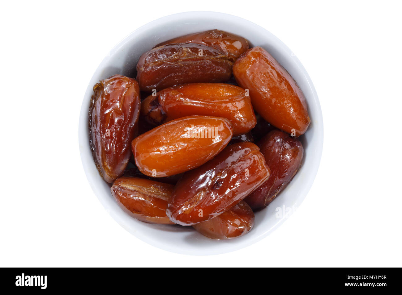 Dates fruit date from above bowl isolated on a white background - Stock Image