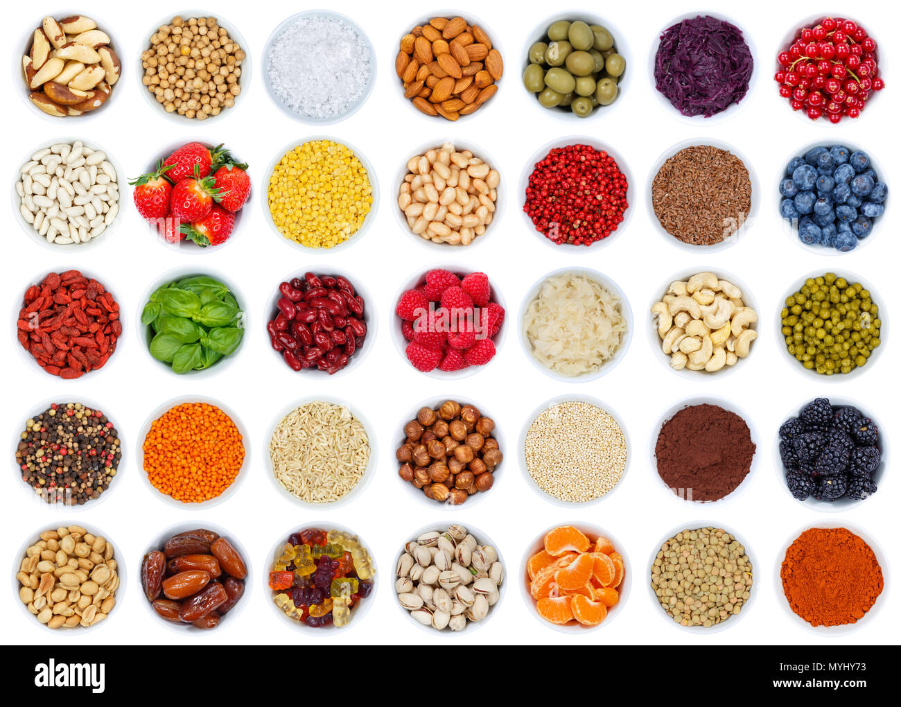 Collection of fruits and vegetables berries from above isolated on a white background - Stock Image