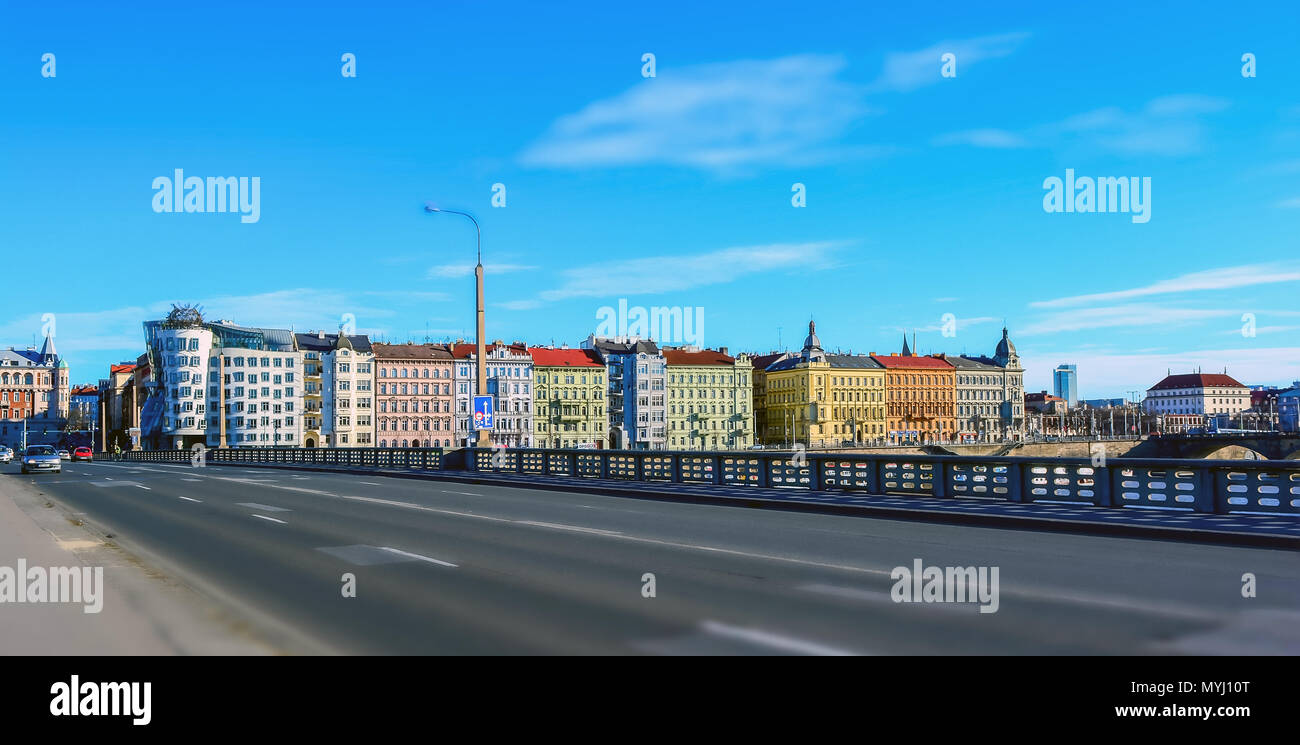 View on the Prague colorful buildings from the bridge across the Vltava on bright, sunny summer day. Diorama effect Stock Photo