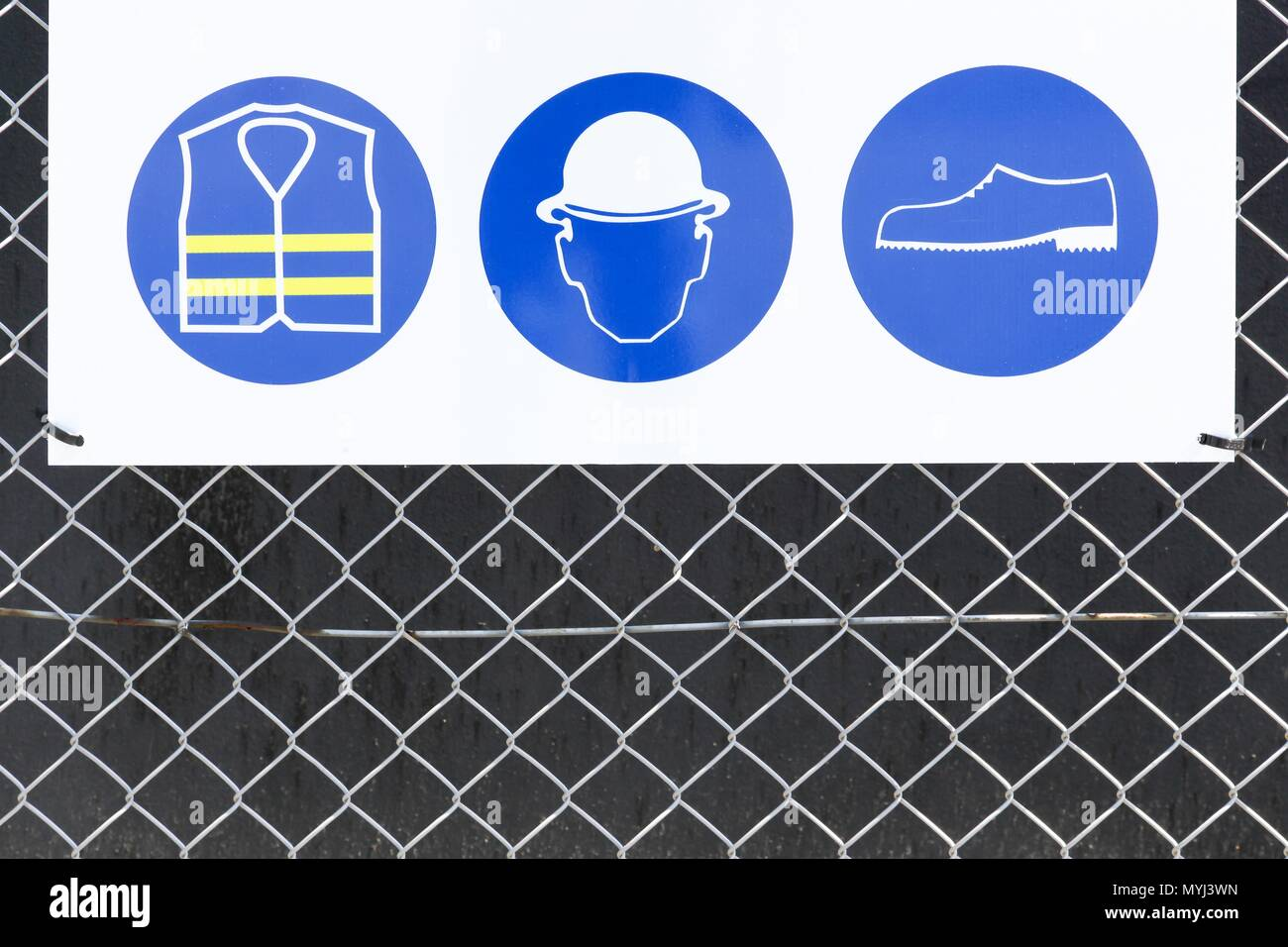 Safety signs on an industrial site - Stock Image
