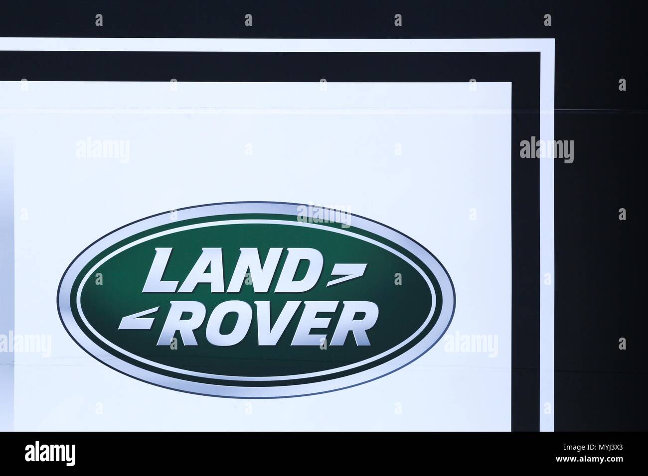 Decines, France - May 24, 2018: Land Rover logo on a wall. Land Rover is a car brand that specialises in four-wheel-drive vehicles, - Stock Image