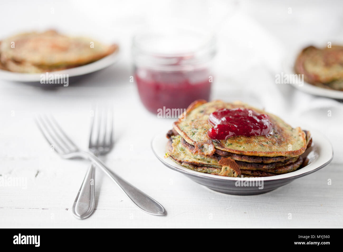 Homemade spinach pancakes with lingonberry jam Stock Photo