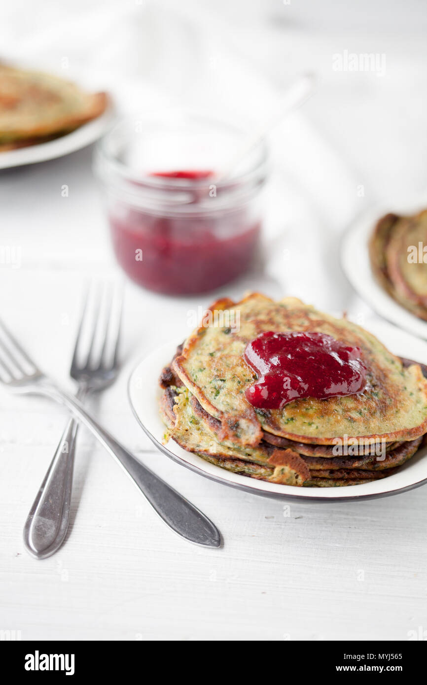 Homemade spinach pancakes with lingonberry jam - Stock Image