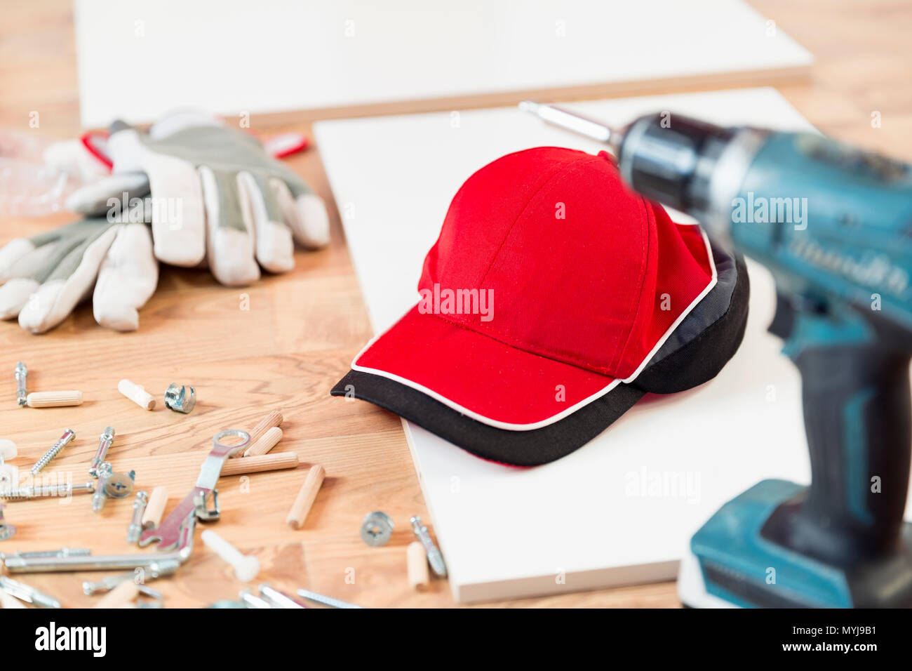 Furniture assembly parts and tools for self assembly furniture, on the floor - Stock Image