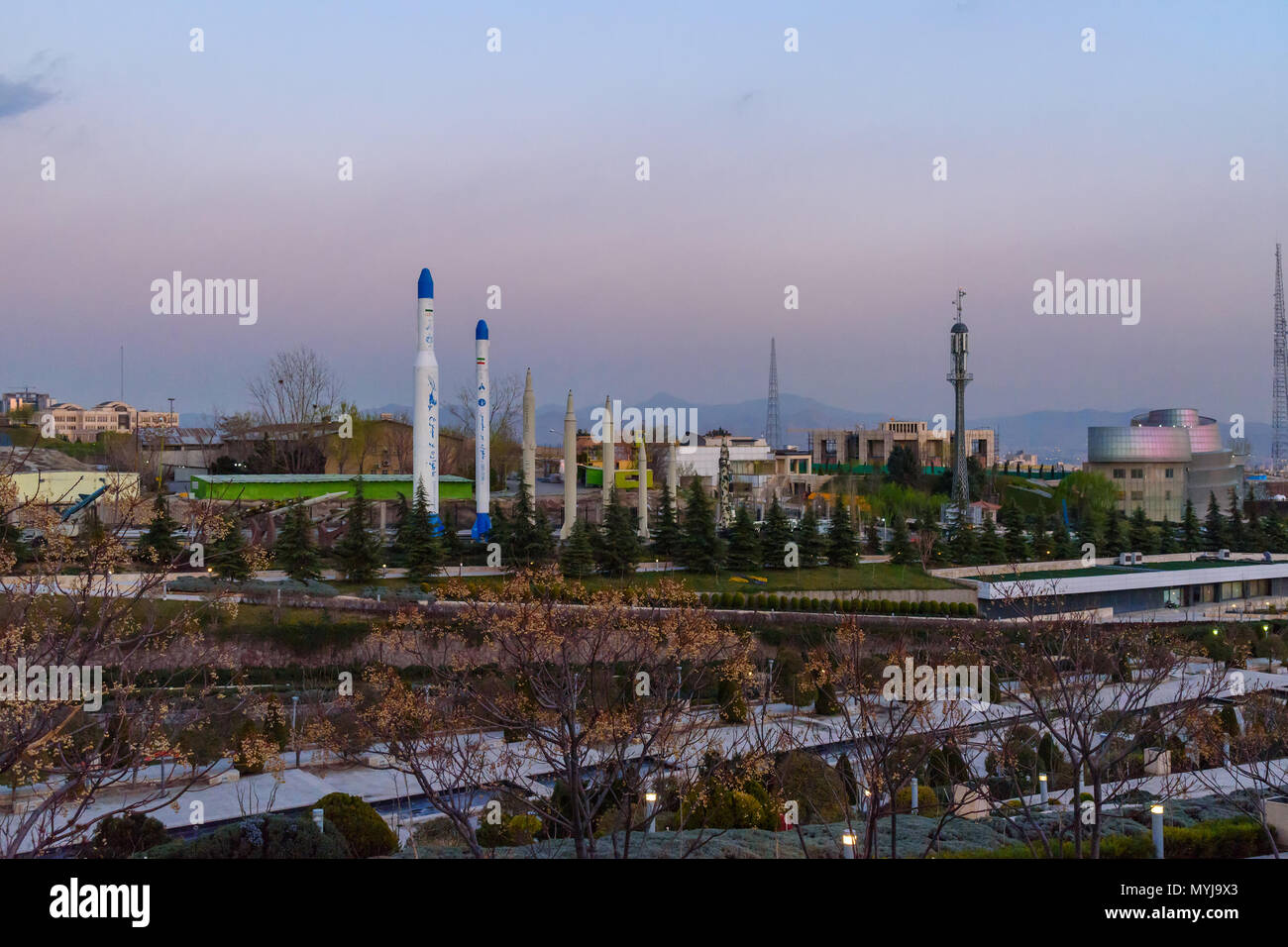 Tehran, Iran - March 18, 2018: View of Iranian missiles in Holy Defense Museum at sunset - Stock Image