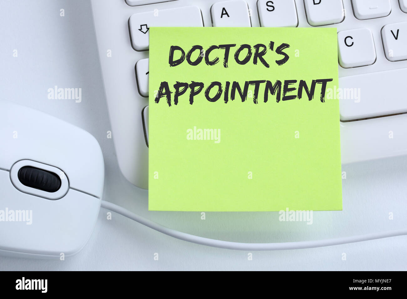 Doctor's medical appointment doctor medicine ill illness healthy health business concept mouse computer keyboard - Stock Image