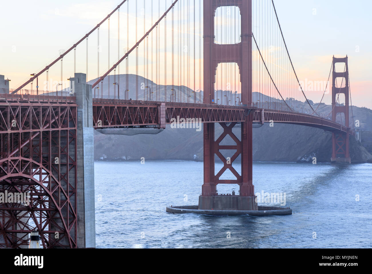 Sunset over the Golden Gate Bridge as seen from the span's southern end. - Stock Image
