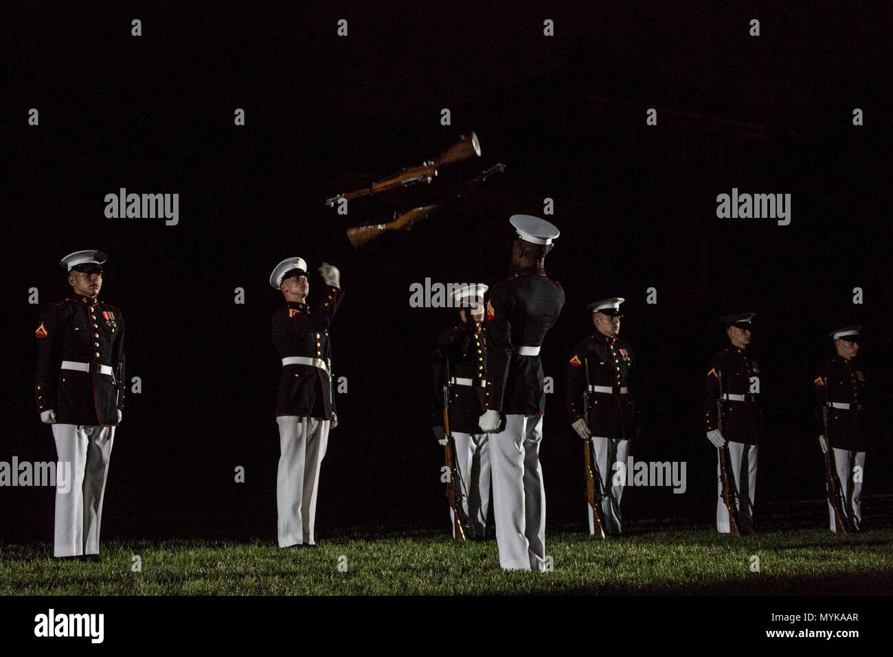 The U.S. Marine Corps Silent Drill Platoon performs during an evening parade at Marine Barracks Washington, Washington, D.C., May 05, 2017. Evening parades are held as a means of honoring senior officials, distinguished citizens and supporters of the Marine Corps. Stock Photo