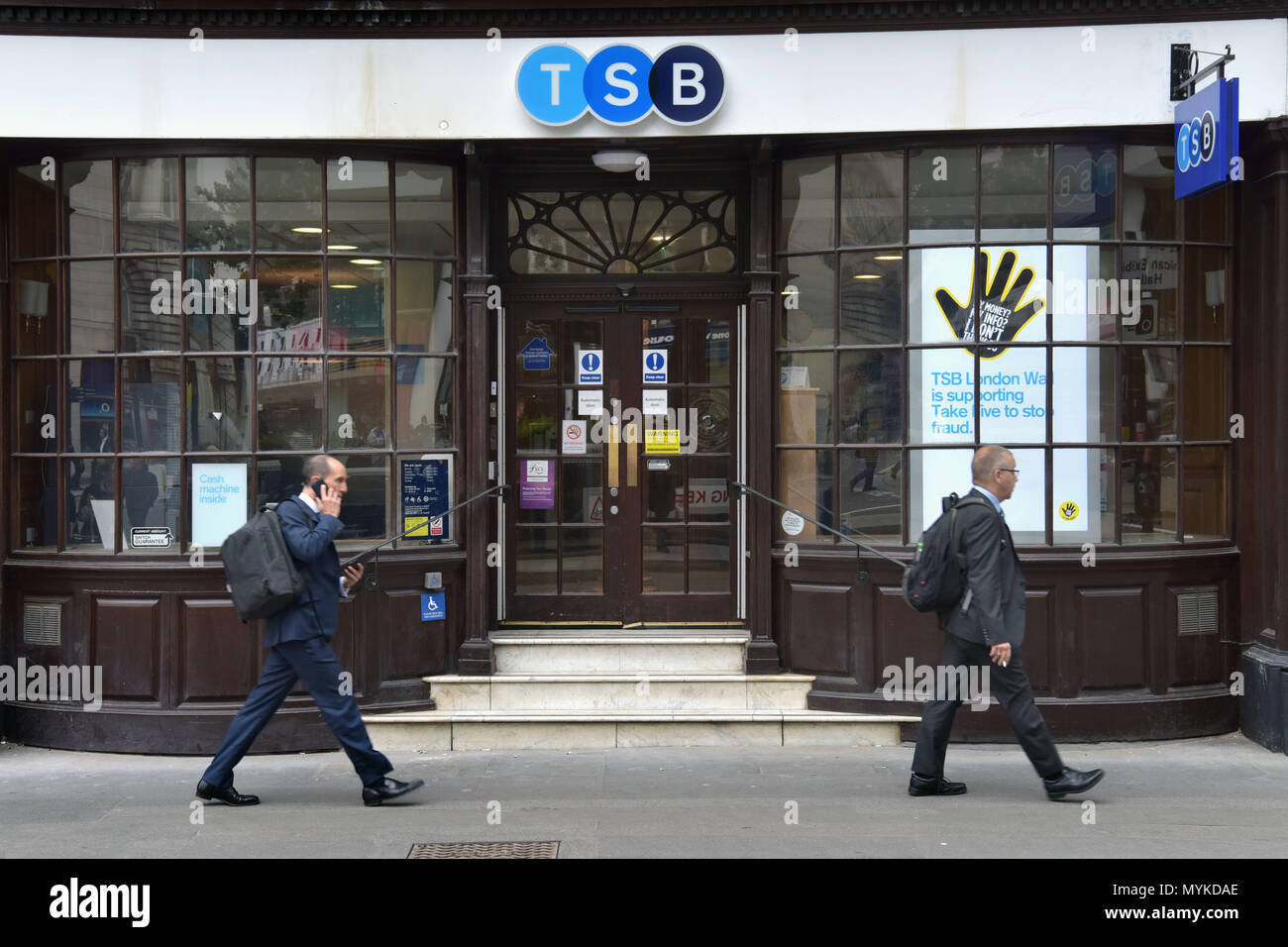 People walk past the bank branch of TSB  on Moorgate in the City of London. - Stock Image
