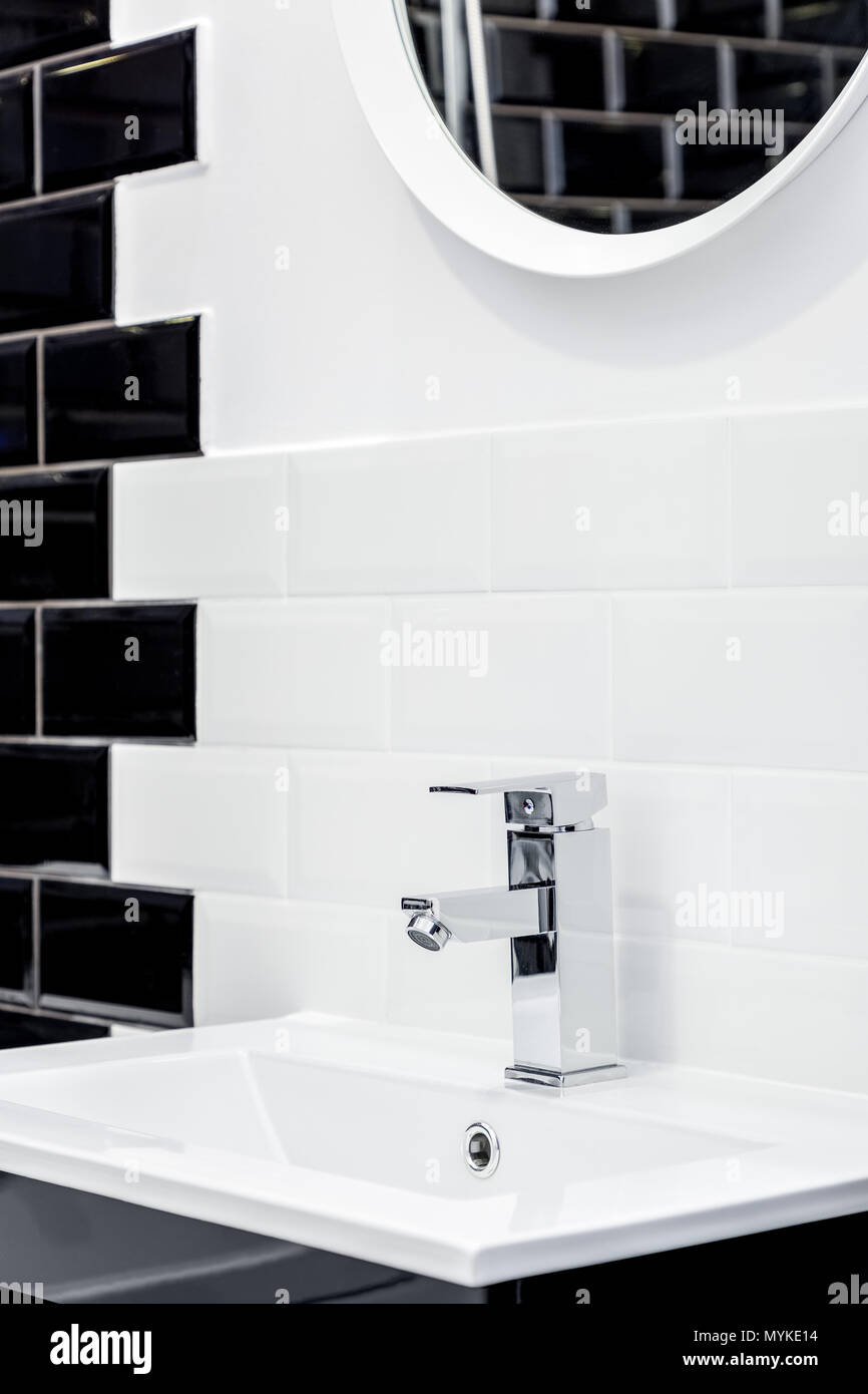 Bathroom with washbasin and modern brick tiles in black and white ...