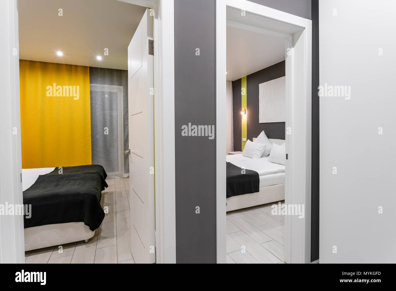 inexpensive family room. Hotel standart two bedroom. simple and stylish interior. interior lighting - Stock Image