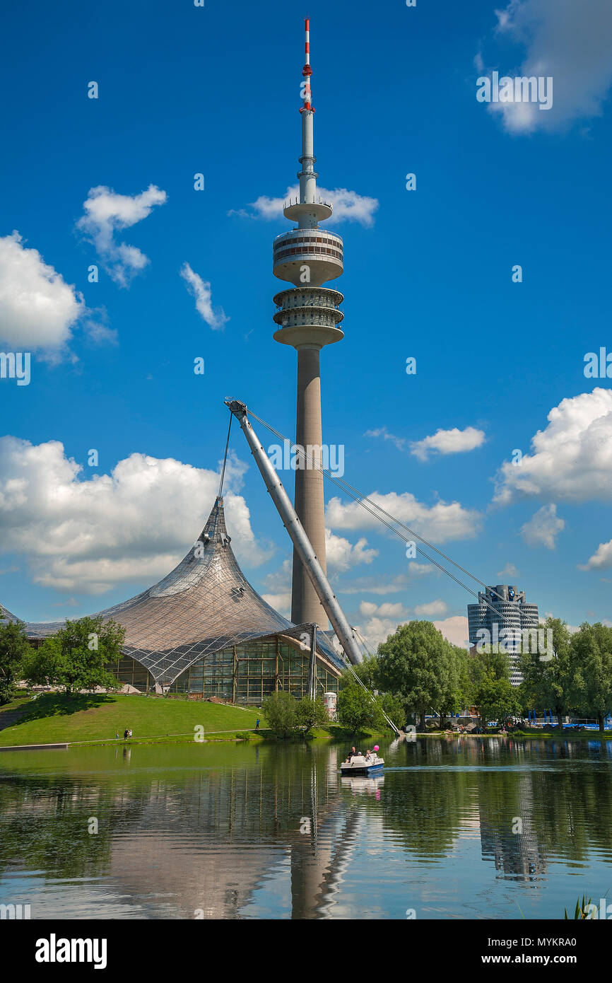 Olympic Park with Olympic Tower, tent roof and lake, cloudy sky, Munich, Upper Bavaria, Bavaria, Germany - Stock Image