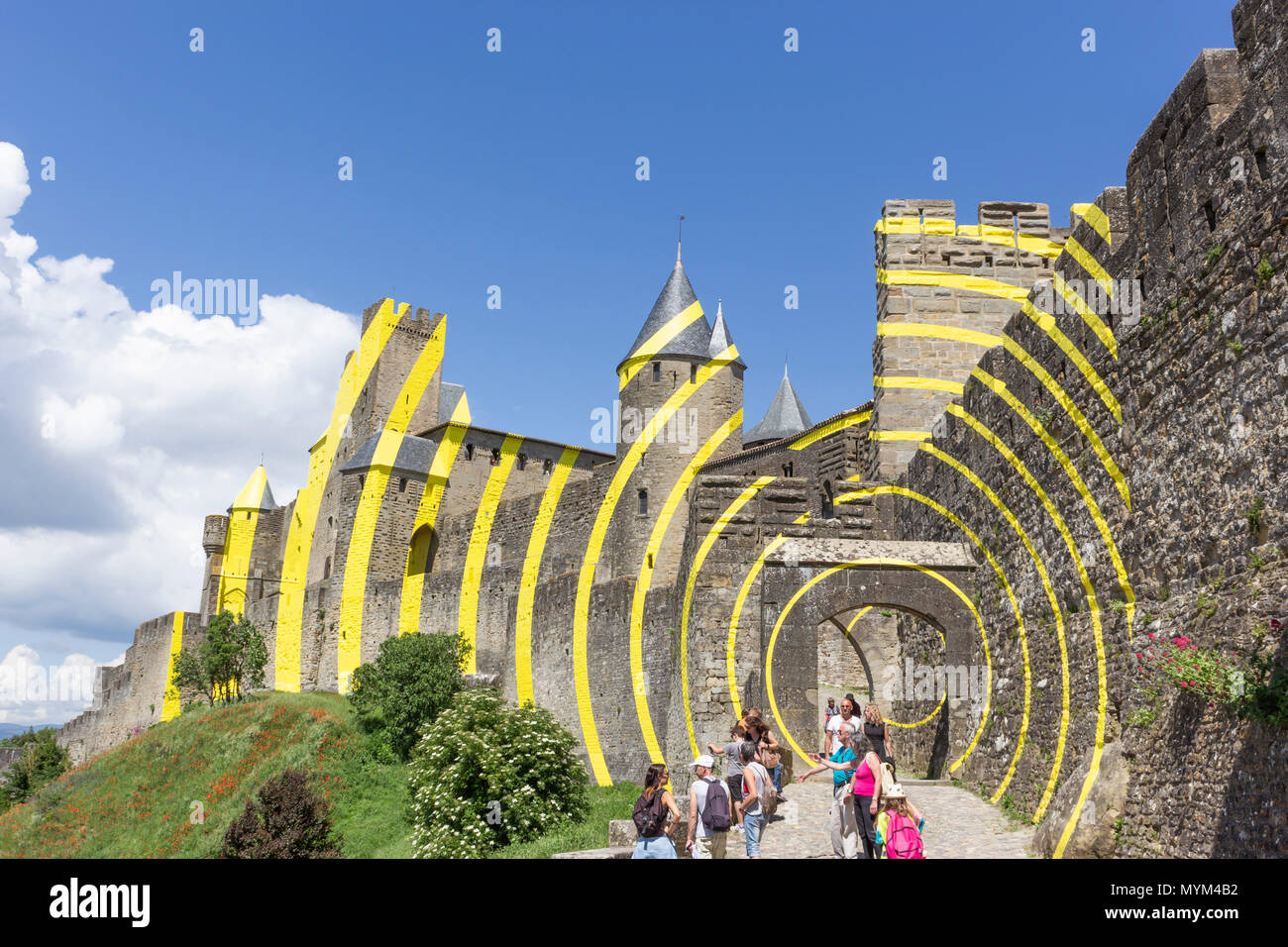 The Cité of Carcassonne, French department of Aude, Occitanie Region, France. The yellow paint is the Felice Varini, project of concentric yellow circ - Stock Image