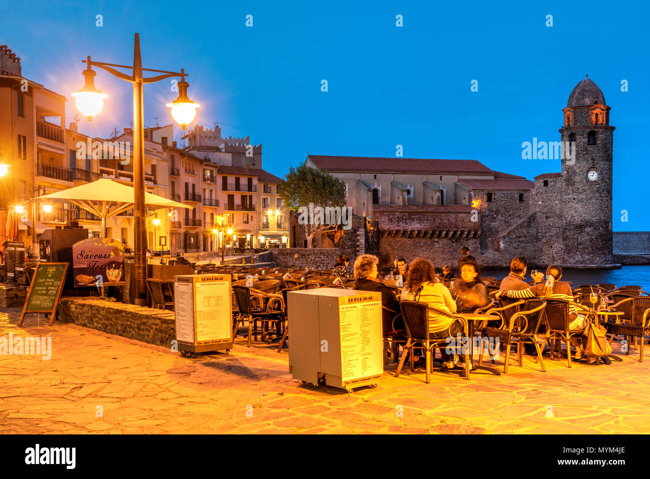 Outdoor cafe on the beach, Collioure, Pyrenees-Orientales, France - Stock Image