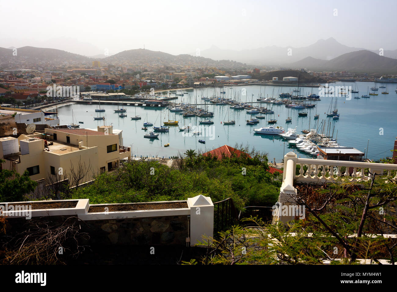 MINDELO, CAPE VERDE - DECEMBER 07, 2015: Marina of Sao Vicente island with boats and yachts and view of the Mindelo port city Stock Photo
