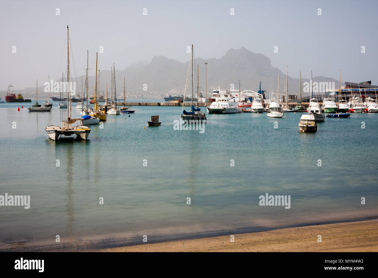 MINDELO, CAPE VERDE - DECEMBER 07, 2015: Boats and yachts in Marina of Sao Vicente island. Visible Face Mountian Stock Photo