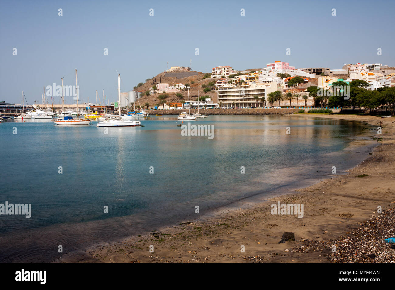 MINDELO, CAPE VERDE - DECEMBER 07, 2015: Sailboats in Marina of Sao Vicente island. Visible Fortim do Rei and maritime port agency AMP Stock Photo