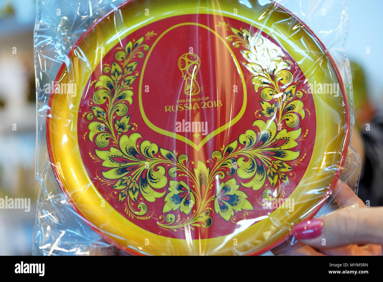 St. Petersburg, Russia - May 31, 2018: Official Khokhloma painted souvenirs of FIFA World Cup 2018 presented on the fair Nevsky Larets. Khokhloma is a - Stock Image