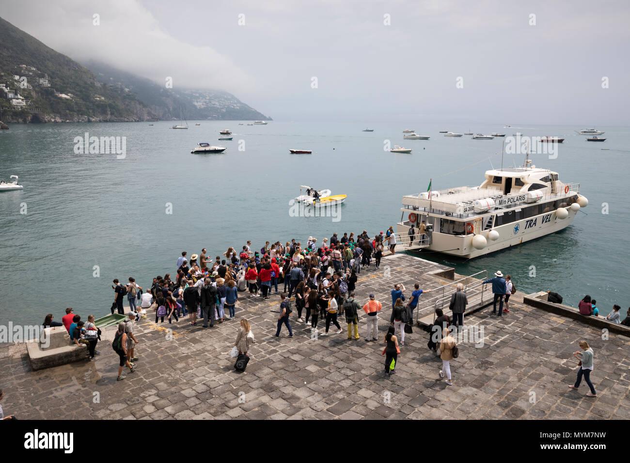 Tourists boarding ferry, Positano, The Amalfi Coast, Campania, Italy, Europe Stock Photo