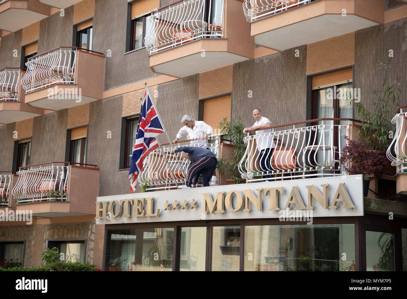 Putting up flags on the outside of the Hotel Montana, Sant' Agata, Sorrento Peninsula, Campania, Italy, Europe - Stock Image