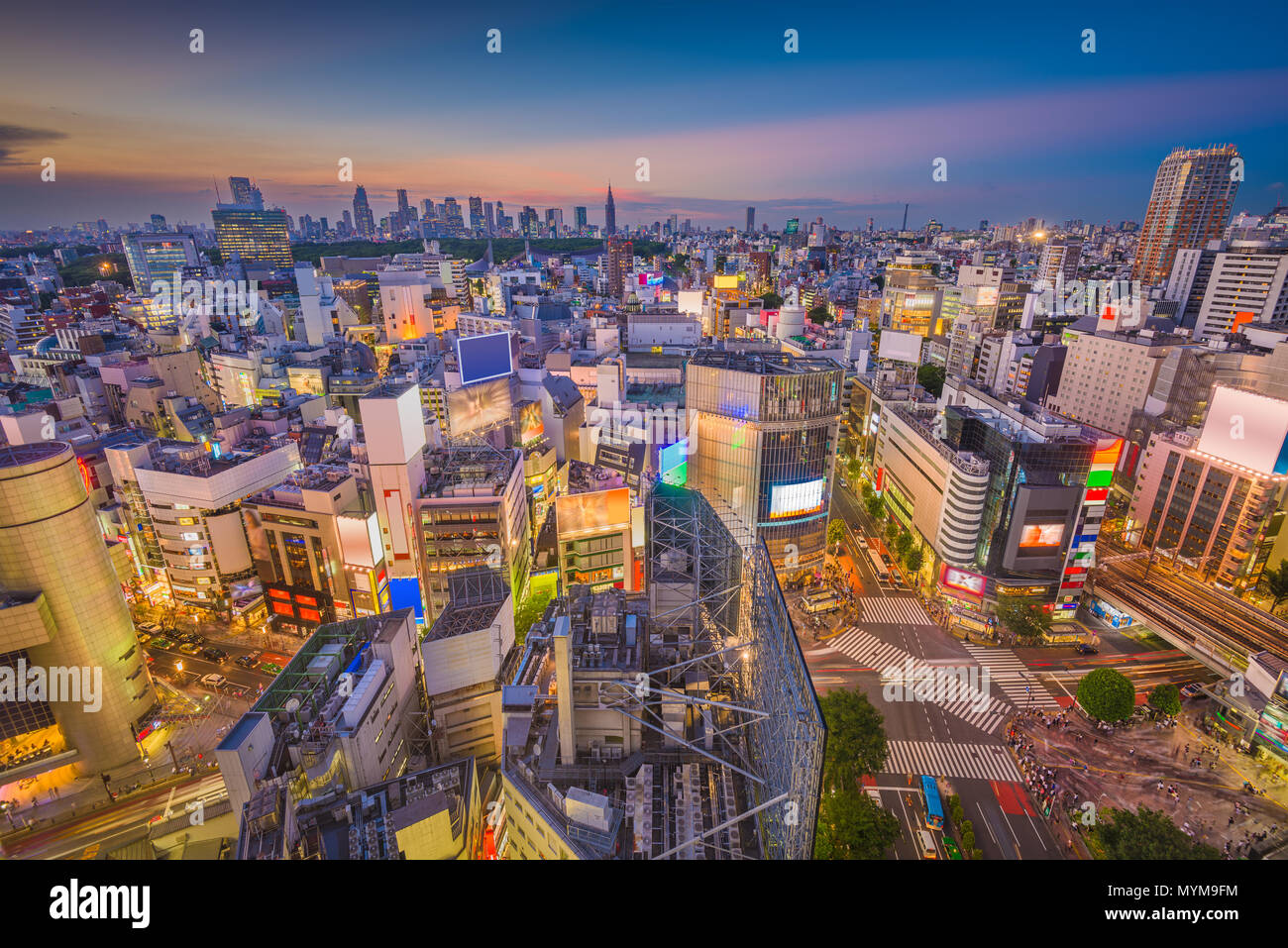 Shibuya, Tokyo, Japan city skyline over the famous scramble crosswalk at dusk. Stock Photo