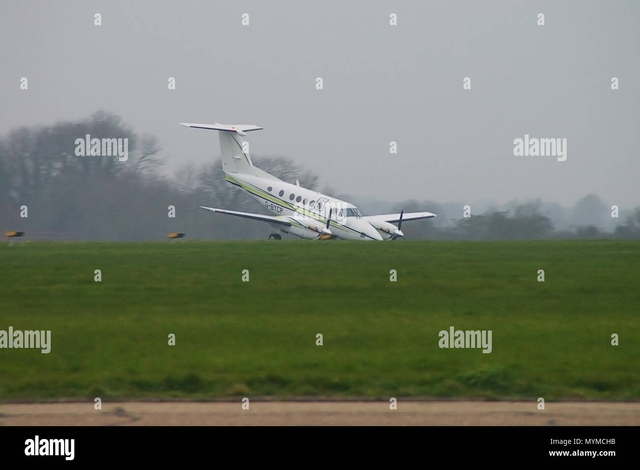 Beech B200 Super Kingair G-BYCP suffered a nose gear undercarriage collapse on landing at London Southend Airport. Emergency landing - Stock Image