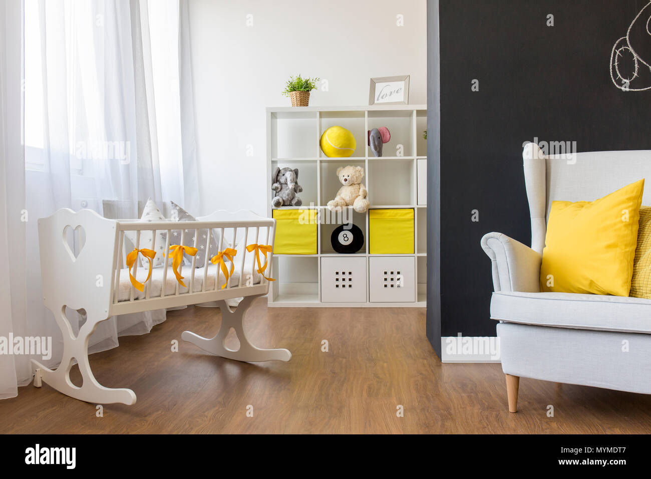 Shot of a cozy nursery room with a blackboard wall - Stock Image