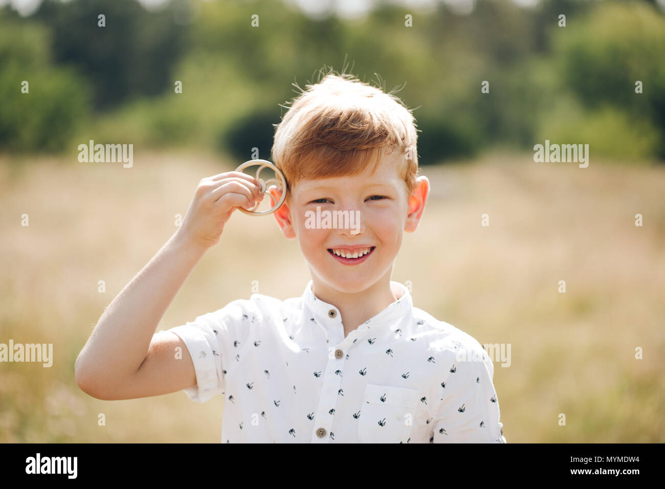 6 years old boy playing with spinner - Stock Image