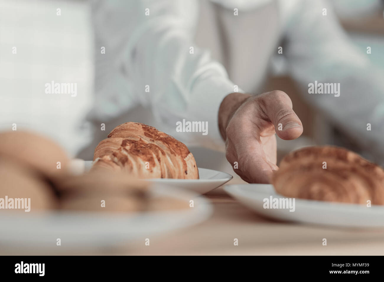 Focused photo on croissant that being on plate - Stock Image