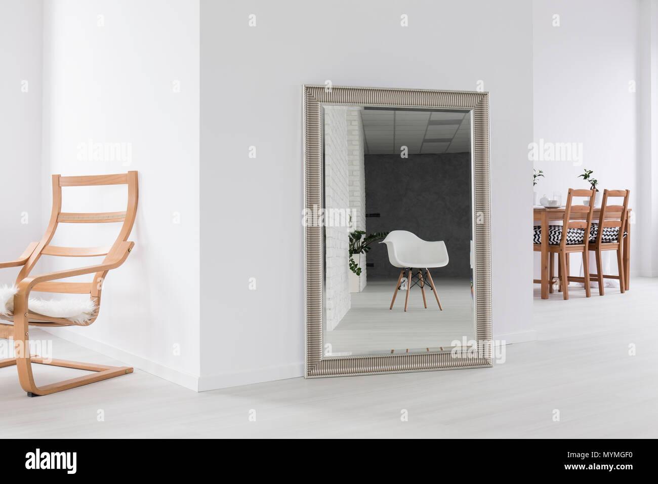 Big mirror in silver frame in white spacious interior Stock Photo ...