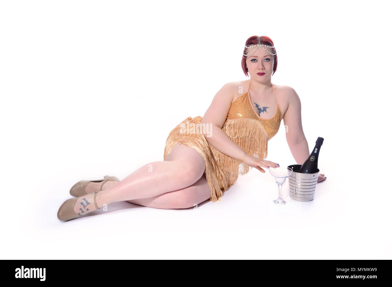 1920s flapper girl drinking alcohol Stock Photo