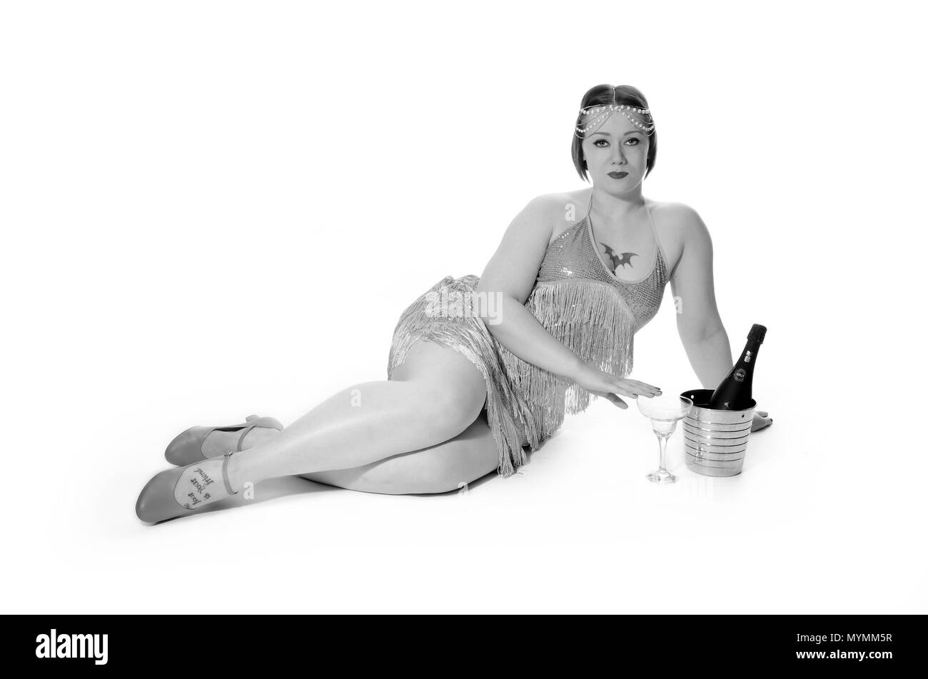 1920s flapper girl drinking alcohol - Stock Image