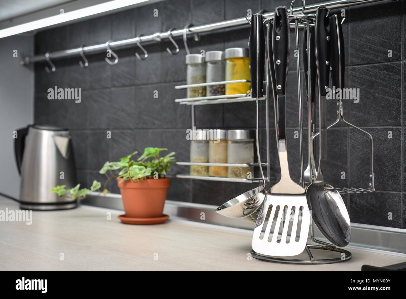 Kitchen utensils on work top in modern kitchen closeup Stock Photo