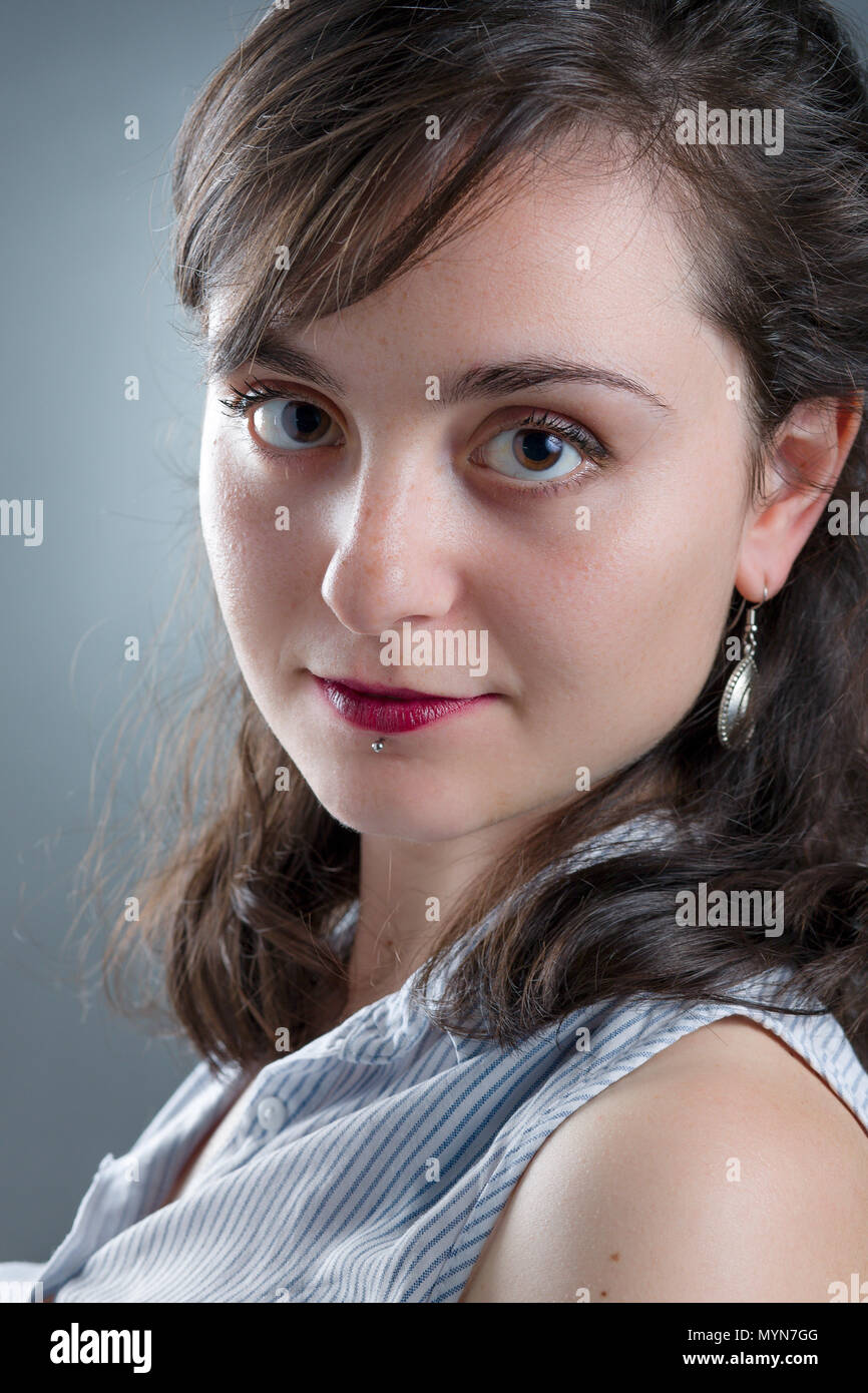 Pretty Girl with Red Lipstick and Labret Piercing - Stock Image
