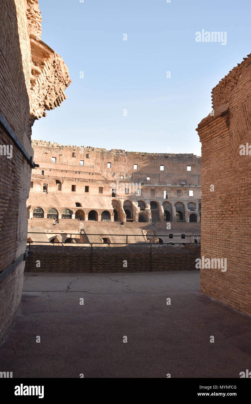 View from an entrance into the Colosseum (Coliseum) or Flavian Amphiteatre in the centre of Rome, Italy. Stock Photo