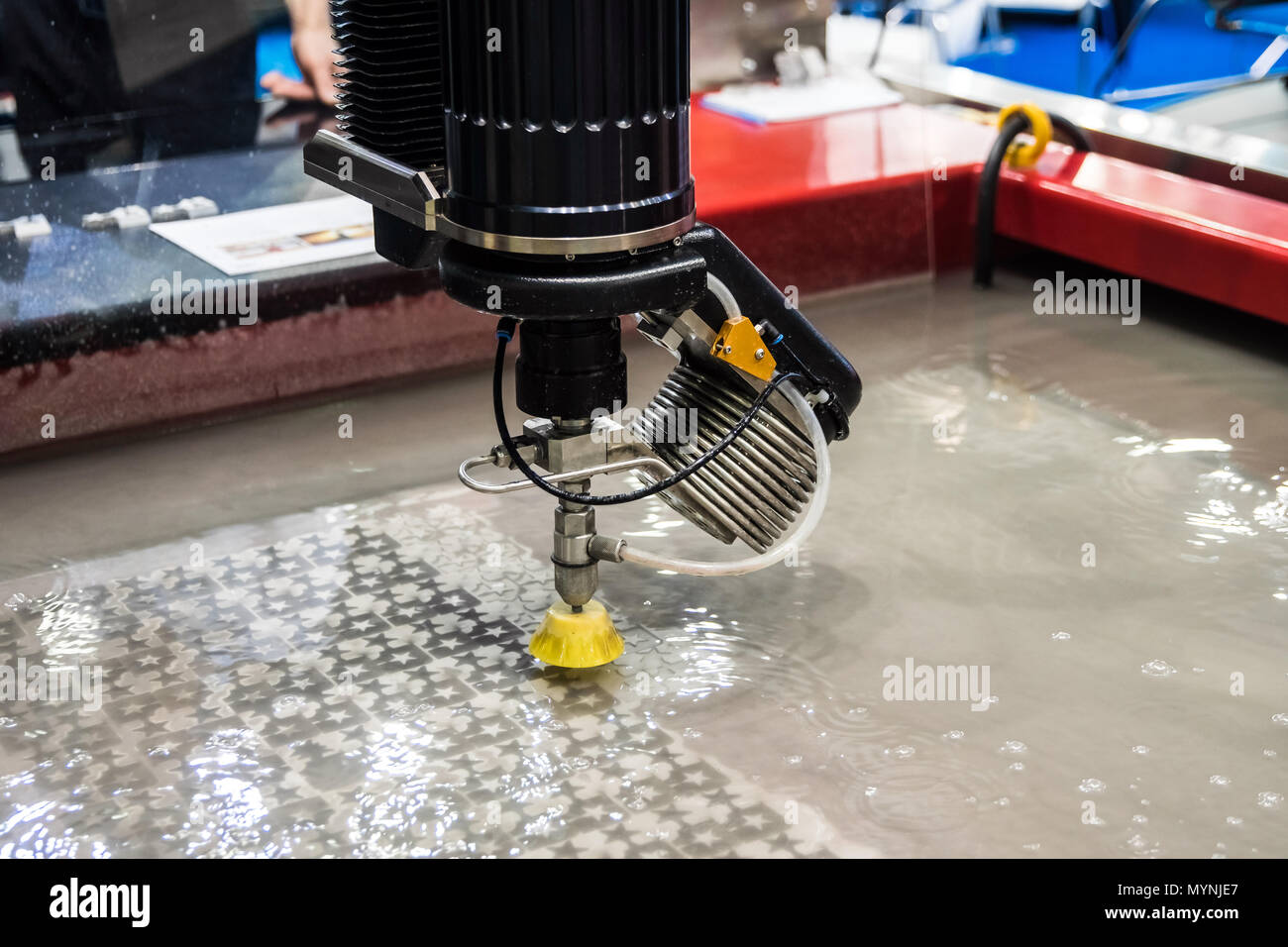Precision 5 axis cutting head with direct drive technology - Stock Image