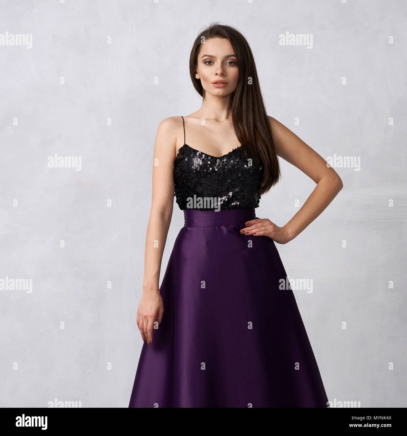 2ac8ca8ce9ec4 Young woman in formal dress with black sequin top and purple sa - Stock  Image