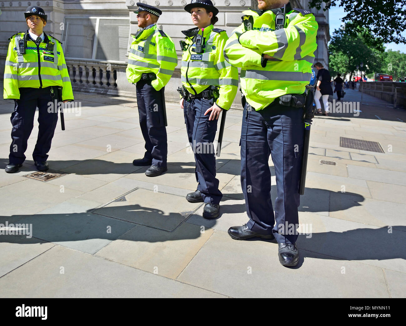 Police officers in Hi-Vis jackets in Whitehall, Westminster, London, England, UK. - Stock Image