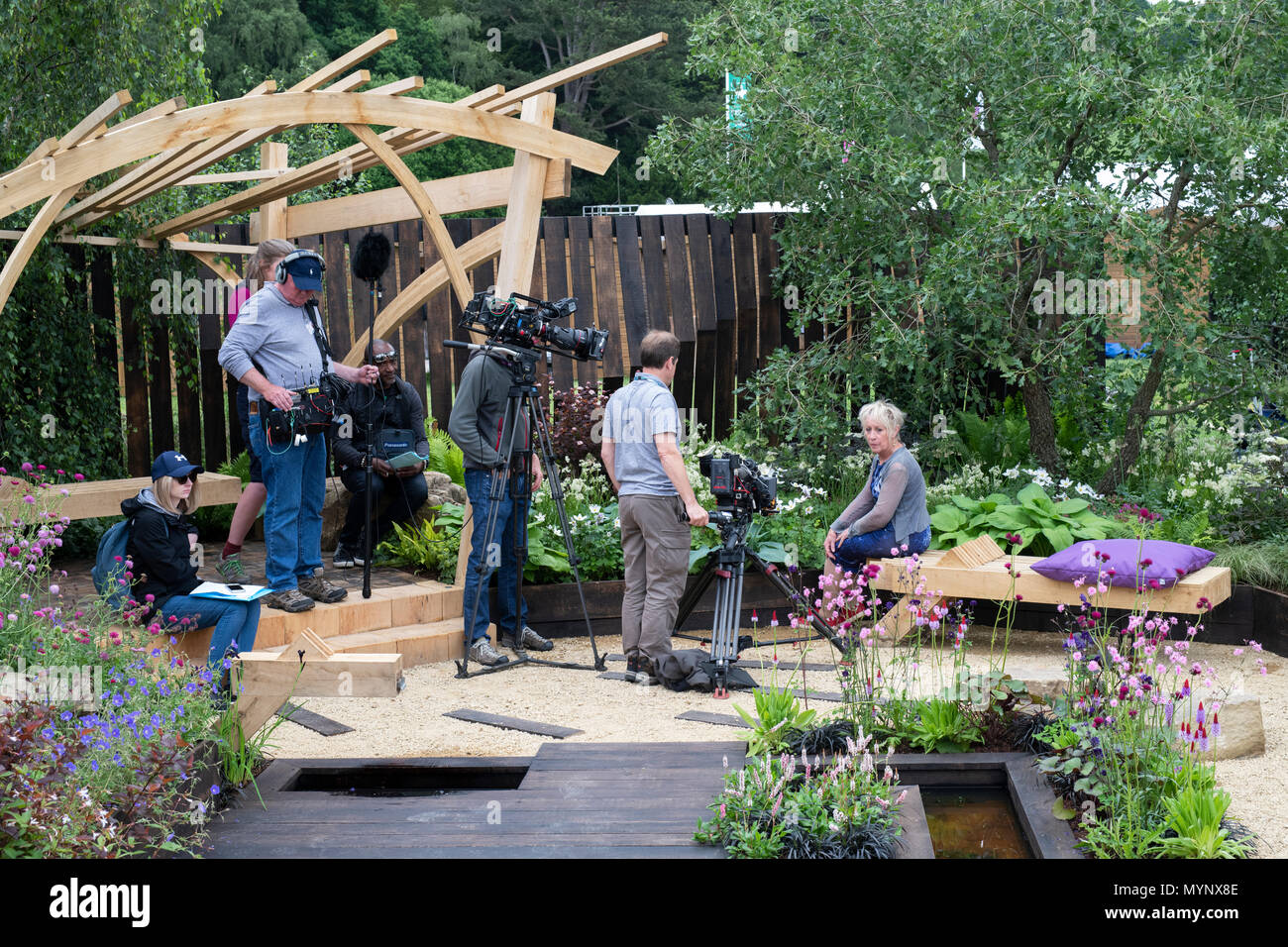 BBC Gardeners world film crew with Carol Klein in The Great Outdoors show garden at RHS Chatsworth flower show 2018. Chatsworth, Derbyshire, England - Stock Image