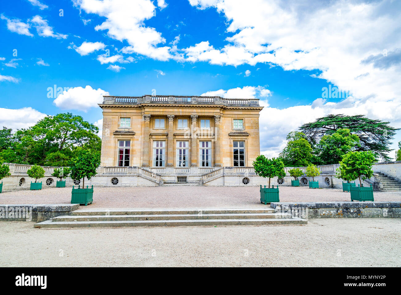 The West facade of the Petit Trianon, by Ange-Jacques Gabriel within the gardens of Versailles in France. - Stock Image