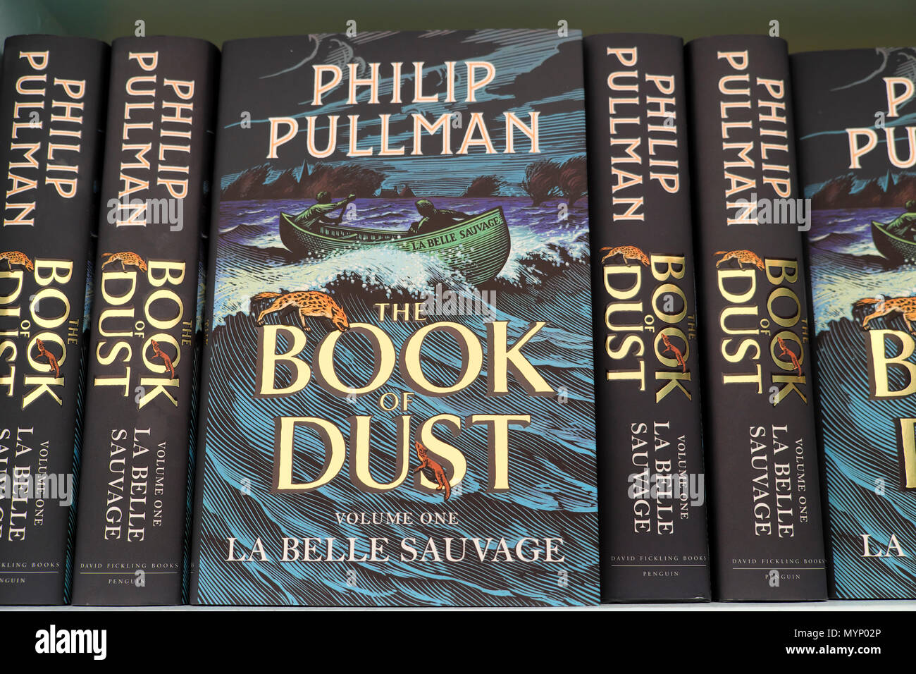 Book cover of Philip Pullman  'Book of Dust' books on book shelf at the Hay Festival 2018 bookstore in Hay-on-Wye UK   KATHY DEWITT - Stock Image