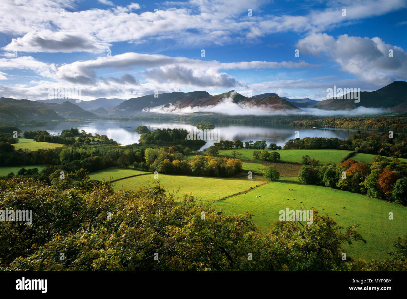View over Derwent Water lake in morning mist, Keswick, The Lake District, Cumbria, England, United Kingdom, Europe - Stock Image