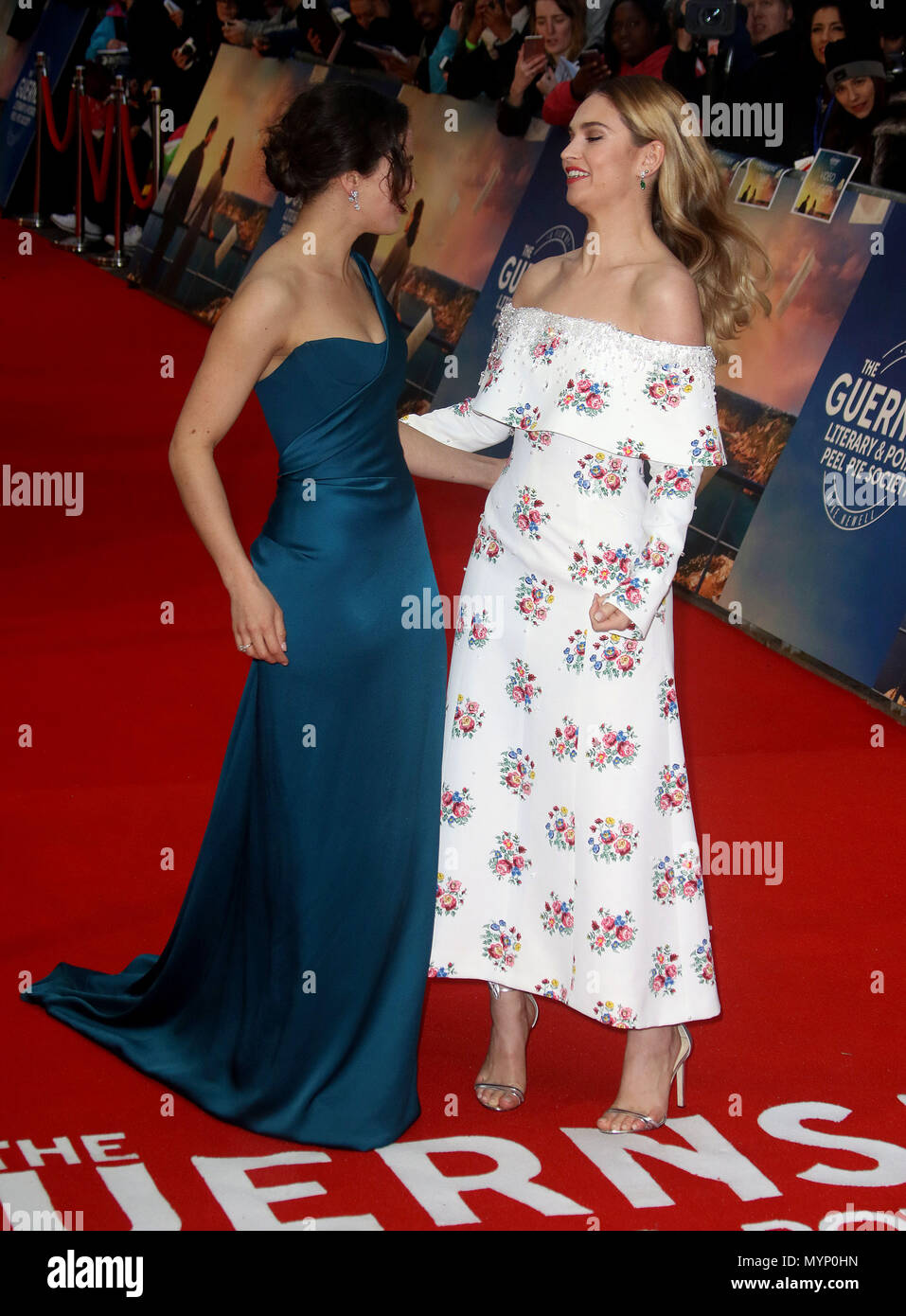 April 9, 2018 - Jessica Brown Findlay and Lily James attending The Guernsey Literary and Potato Peel Pie Society World Premier, Curzon Mayfair in Lond - Stock Image